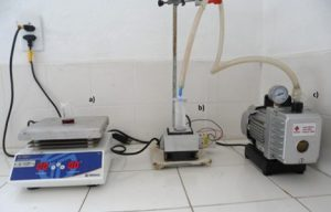 Instrumentation used to prepare the nanofoams. From the left: heating plate to keep the solution above the phase separation temperature, Peltier cooling system and vacuum pump for solvent removal by sublimation.